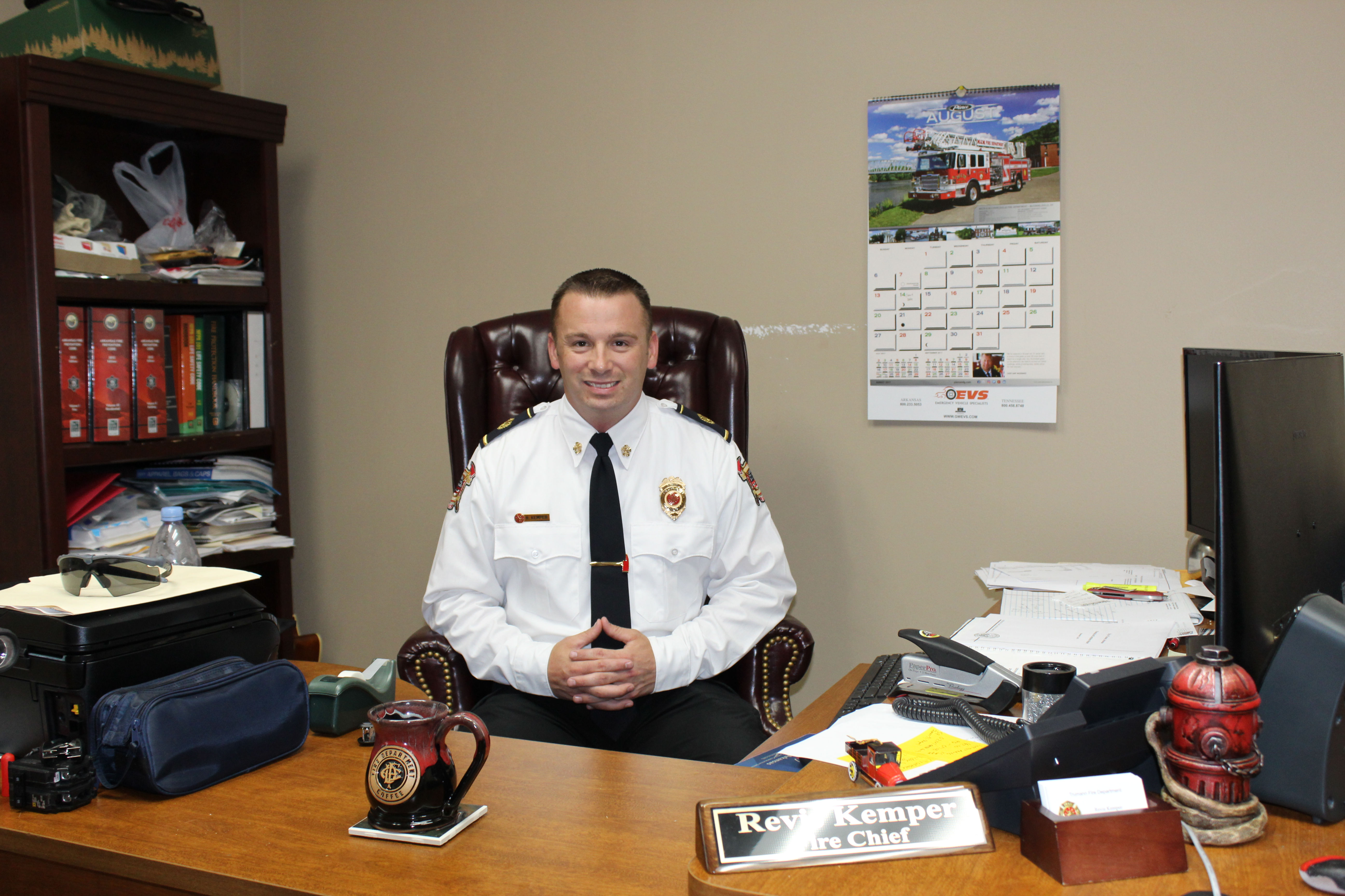 Trumann Fire Chief Revis Kemper sitting at his desk